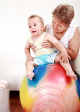 Playing with gymnastic ball. Small boy have a fun with the gymnastic ball Stock Photography