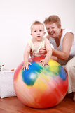 Playing with gymnastic ball. Small boy have a fun with the gymnastic ball Stock Image
