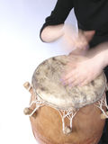 Playing handdrum. Playing African ethnic kpalogo drum Royalty Free Stock Images