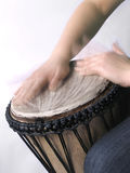 Playing handdrum. A close up of a djembe drum while playing stock photo