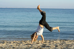 Playing handstand beach. Boy playing handstand on beach Royalty Free Stock Photography