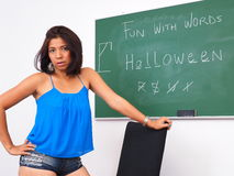 Attractive woman plays hangman on chalkboard Stock Photo