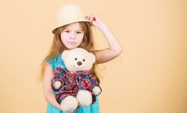 Playing with her favorite toy. Little girl holding soft toy. Small child cuddling teddy bear toy. Adorable girl child. With cute stuffed animal doll. Toy is stock photos