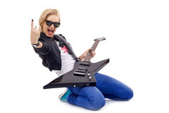 Playing on her knees. Passionate rock girl playing an electric guitar on her knees Stock Photos