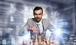 Playing his business strategy . Mixed media Stock Photo