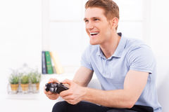 Playing his favorite video game. Royalty Free Stock Photography