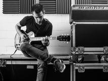 Playing his guitar backstage Stock Photos