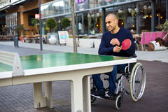 Playing in his wheelchair royalty free stock photo