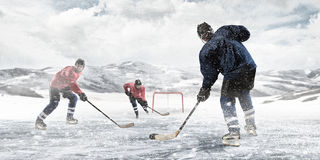 Playing Hockey Game Stock Images