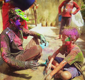Playing Holi with brother. Playing and celebrating holi Festival with my little brother royalty free stock photos