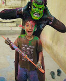Playing holi with my brother. Every year we we celebrate holi and play with colours ,doing crazy things stock photo