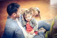 Playing at home. Family at home. stock photos