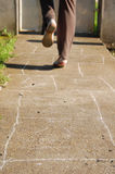 Playing hopscotch Stock Photography