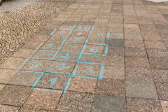 Playing hopscotch in the street Royalty Free Stock Photography