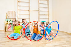 Playing with hula hoops stock photography