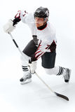 Playing ice hockey. Portrait of healthy sportsman playing hockey on ice Stock Photography