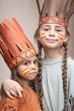 Playing Indians. Two sisters dressed as Indians Stock Images