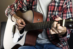 Playing instrument at home stock photography