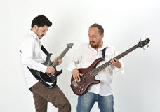 Playing instruments. A couple of musicians playing instruments Stock Photos