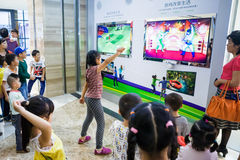 Playing interactive games with kinect xbox 360. Liuzhou,China,November 9,2013:A little girl playing the video games with kinect 'xbox 360 ' in a shopping mall Royalty Free Stock Image
