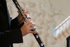 Playing jazz. Hand of flautist playing during a live jazz session Stock Image