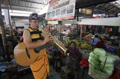 Playing jazz in traditional market Stock Images