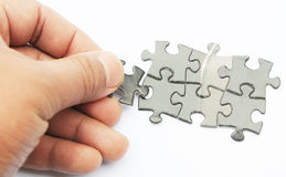 Playing jigsaw Stock Photo