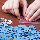 Playing with jigsaw puzzles Stock Photos