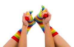 Playing Joyful Feet. Childish colorful happy striped sock playing Stock Image