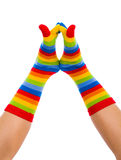Playing Joyful Feet. Childish colorful happy striped sock playing Stock Photography