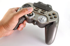 Playing with joypad on white background Royalty Free Stock Photography