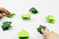 Playing Jumping Frogs Game Stock Photography