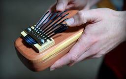 Playing the Kalimba. Close up of hands playing the kalimba or thumb piano Stock Image
