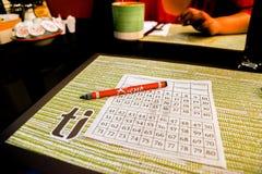 Playing Keno at Treasure Island Hotel and Casino. Picking numbers for Treasure Island Keno game stock image