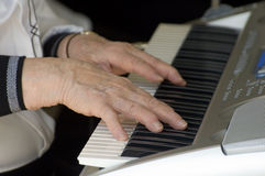 Playing the keyboard. Closeup of hands playing keyboard Royalty Free Stock Images