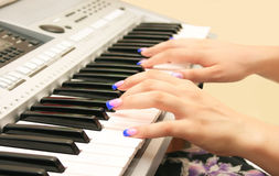 Playing keyboard Stock Images