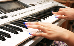 Playing keyboard Stock Photography