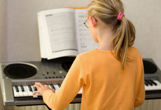 Playing keyboard Stock Image
