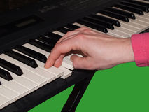 Playing keyboard with right hand Stock Photo