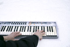 Playing Keyboard In Winter Stock Images