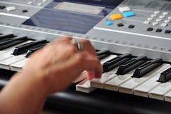 Playing keyboards. Musician playing electronic keyboards, closeup Royalty Free Stock Image