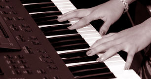 Playing Keybroad. Lady hand playing keybroad Royalty Free Stock Photo