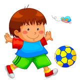 Playing kid. Little boy playing with his soccer ball Royalty Free Stock Image
