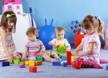 Playing kids. Group of kids playing with constructor Stock Images