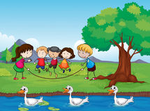 Playing kids and ducks in water Royalty Free Stock Photo