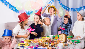 Playing kids having a good time at a birthday party Royalty Free Stock Photos