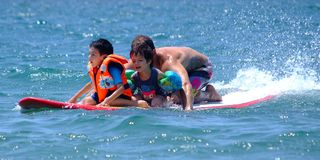 Family on surf board Royalty Free Stock Image
