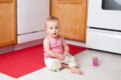 Playing in the kitchen Royalty Free Stock Images