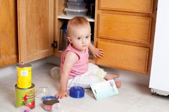 Playing in the kitchen Stock Photos
