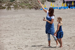 PLaying with a kite. Mother and daughter trying to get a kite into the air Stock Images